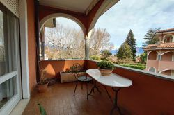 living three-room apartment with balcony in Stresa green area, for sale real estate